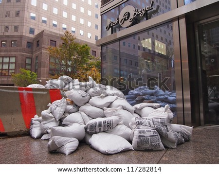 NEW YORK - OCT 30: Sandbags protect the entrance to a bagel shop in Lower Manhattan on October 30, 2012 in New York City, NY. Superstorm Sandy shut down much of the city. - stock photo