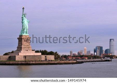 NEW YORK - OCT 15: Statue of liberty on Oct 15 2010.After 9/11 attacks it was closed.In 2004 the pedestal reopened and the statue in 2009 with limits on number of visitors allowed ascend to the crown. - stock photo