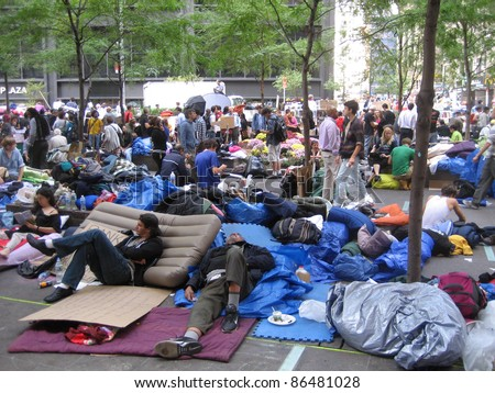 NEW YORK - OCT 11: Unidentified Occupy Wall Street protesters camp out in Zuccotti Park, Lower Manhattan, on October 11, 2011 in New York City. The protest started September 17. - stock photo