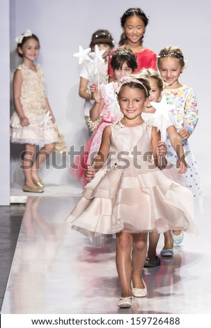NEW YORK - OCTOBER 5: A model walks during the Swarovski finale at petitePARADE NY Kids Fashion Week in Collaboration with Vogue Bambini on  OCTOBER 5, 2013 in New York - stock photo
