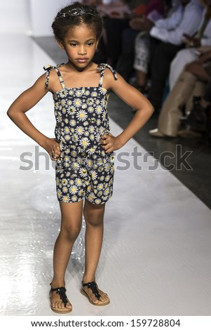 NEW YORK - OCTOBER 5: A model walks the Baby CZ by Carolina Zapf preview during the Swarovski at petitePARADE NY Kids Fashion Week in Collaboration with Vogue Bambini on  OCTOBER 5, 2013 in New York - stock photo