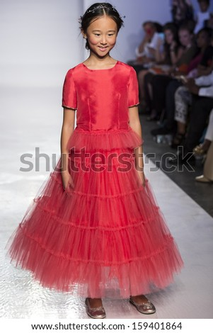 NEW YORK - OCTOBER 5: A model walks the runway at Junior Gaultier Couture preview during the Swarovski at petitePARADE NY Kids Fashion Week on  OCTOBER 5, 2013 in New York - stock photo