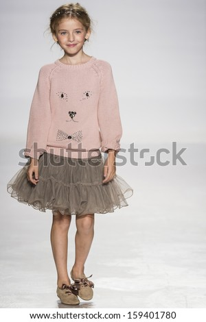 NEW YORK - OCTOBER 5: A model walks the runway at Lili Gaufrette preview during the Swarovski at petitePARADE NY Kids Fashion Week in Collaboration with Vogue Bambini on  OCTOBER 5, 2013 in New York - stock photo
