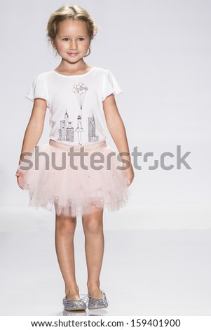 NEW YORK - OCTOBER 5: A model walks the runway at Milly Minis preview during the Swarovski at petitePARADE NY Kids Fashion Week in Collaboration with Vogue Bambini on  OCTOBER 5, 2013 in New York - stock photo