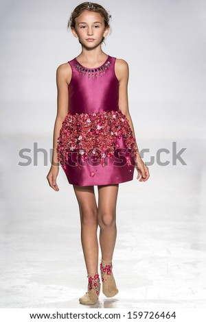 NEW YORK - OCTOBER 5: A model walks the runway at Mischka Aoki preview during the Swarovski at petitePARADE NY Kids Fashion Week in Collaboration with Vogue Bambini on  OCTOBER 5, 2013 in New York - stock photo