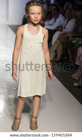 NEW YORK - OCTOBER 5: A model walks the runway at Pale Cloud preview during the Swarovski at petitePARADE NY Kids Fashion Week in Collaboration with Vogue Bambini on  OCTOBER 5, 2013 in New York - stock photo
