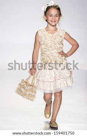 NEW YORK - OCTOBER 5: A model walks the runway at Pituchinhu's preview during the Swarovski at petitePARADE NY Kids Fashion Week in Collaboration with Vogue Bambini on  OCTOBER 5, 2013 in New York - stock photo