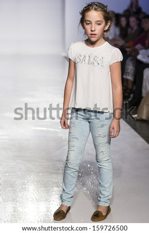 NEW YORK - OCTOBER 5: A model walks the runway at Salsa preview during the Swarovski at petitePARADE NY Kids Fashion Week in Collaboration with Vogue Bambini on  OCTOBER 5, 2013 in New York - stock photo