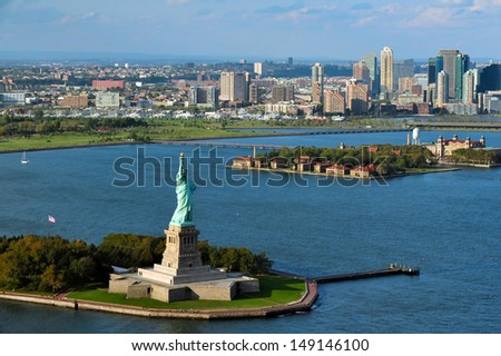 NEW YORK - OCTOBER 15: Aerial view of the Statue of Liberty on October 15 2010.It presented to America by the people of France in 1886, the statue sits on 12-acre Liberty Island in New York Harbor. - stock photo