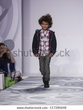 NEW YORK - OCTOBER 5: Boy walks runway for truly scrumptious designed by Heidi Klum at Vogue Bambini petiteParade Kids Fashion Week at Industrial Superstudio on October 5, 2013 in New York City