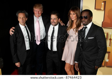 "NEW YORK - OCTOBER 24: Brian Grazer, Donald Trump, Brett Ratner, Melania Trump and Sean Combs (Diddy) attend the premiere of ""Tower Heist"" at the Ziegfeld Theatre on October 24, 2011 in New York City."