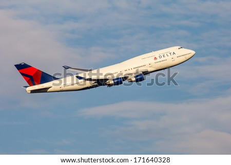 NEW YORK - OCTOBER 9: Delta Boeing 747 takes off from JFK International Airport on October 9, 2013 in New York, USA. Delta is the oldest airline still operating in the United States. - stock photo