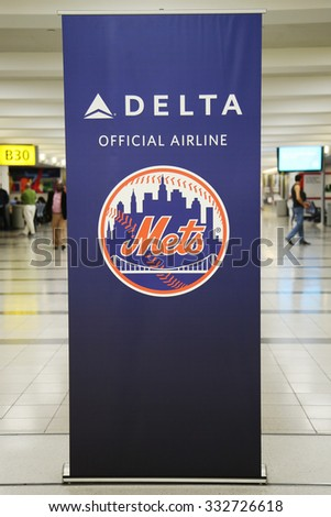 NEW YORK - OCTOBER 25, 2015: Delta official airline of New York Mets sign inside of Delta Airline Terminal 4 at JFK International Airport in New York - stock photo