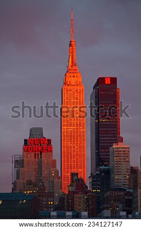 NEW YORK - OCTOBER 19 : Empire state building facade shines at sunset. It was world's tallest building for more than 40 years (from 1931 to 1972), October 19th, 2014 in New York City, USA