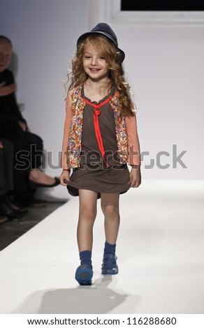 NEW YORK - OCTOBER 20: Girl model walks runway for petite Parade show by Millions of Colors during kids fashion week NYC sponsored by Vogue Bambini at Industria Supertudio on October 20, 2012 in NYC
