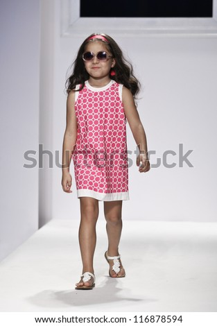 NEW YORK - OCTOBER 20: Girl model walks runway for petite Parade show collection by Baby CZ during kids fashion week NYC sponsored by Vogue Bambini at Industria Superstudio on October 20, 2012 in NYC