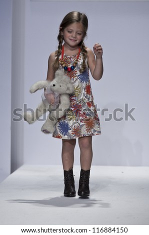 NEW YORK - OCTOBER 20: Girl model walks runway for petite Parade show collection by Imoga during kids fashion week NYC sponsored by Vogue Bambini at Industria Superstudio on October 20, 2012 in NYC