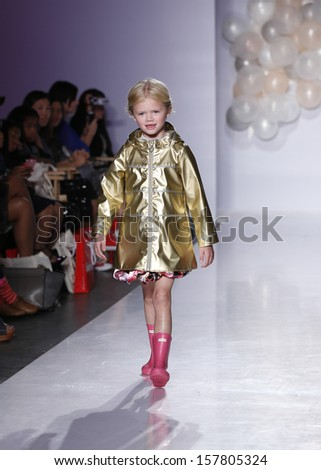 NEW YORK - OCTOBER 6: Girl walks runway for Oil & Water by Amy Wismar at Vogue Bambini petiteParade Kids Fashion Week at Industrial Superstudio on October 6, 2013 in New York City