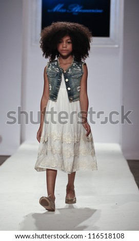 NEW YORK - OCTOBER 21: Girl walks runway for petite Parade show by Miss Blumarine during kids fashion week sponsored by Vogue Bambini at Industria Supertudio on October 21, 2012 in New York City