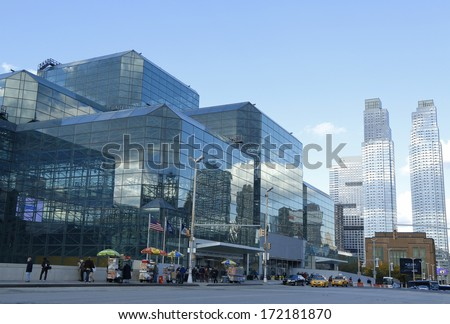 NEW YORK - OCTOBER 24: Javits Convention Center in Manhattan on October 24, 2013. The convention center has a total area space of 1,800, 000 square ft and has 840,000 square ft of total exhibit space - stock photo