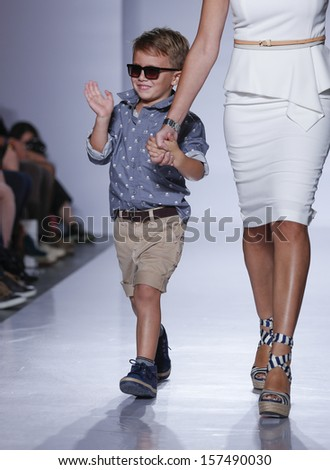 NEW YORK - OCTOBER 5: Model and boy walk runway for Ugg Australia ...