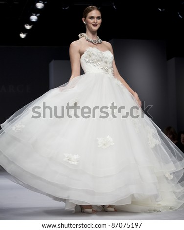 NEW YORK - OCTOBER 16: Model walks runway for Anne Barge bridal collection at New York International Bridal Week at 94 Pier on October 16, 2011 in New York City