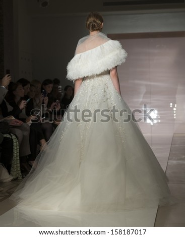 NEW YORK - OCTOBER 11: Model walks runway for Reem Acra during Bridal Week at 5th Avenue studio on October 11, 2013 in New York City