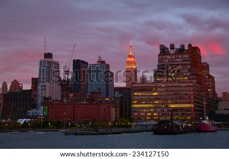 NEW YORK - OCTOBER 19 : Pier 45 and Empire state building facade shines at sunset. It was world's tallest building for more than 40 years (from 1931 to 1972), October 19th, 2014 in New York City, USA
