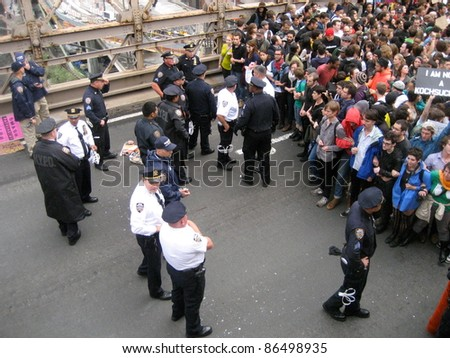 NEW YORK - October 1: Protesters are blocked by policy officers on the Brooklyn Bridge, October 1, 2011 in New York City.