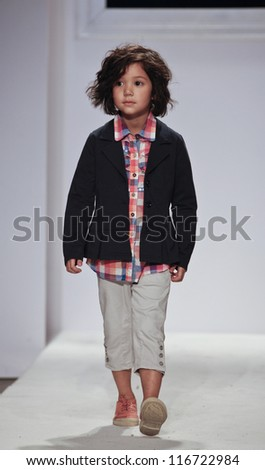 NEW YORK - OCTOBER 21: unidentified Boy walks runway for petite Parade show by Sarabanda during kids fashion week sponsored by Vogue Bambini at Industria Superstudio on October 21, 2012 in New York City