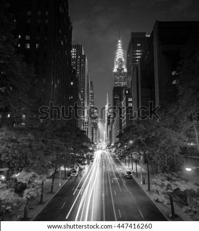 New York's famous 42nd Street at night long exposure with Times Square in the distance in black and white - stock photo