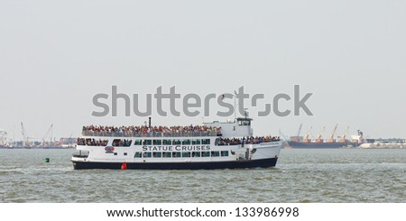 NEW YORK - SEP 3: A Statue Cruises ferry transports tourists from Manhattan to Liberty Island on September 3, 2011 in New York. The company transports more than 3 million visitors yearly. - stock photo
