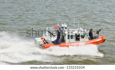 NEW YORK - SEP 3: A U.S. Coast Guard boat on patrol on September 3, 2011 near Liberty Island, New York. As of August 2009 the Coast Guard had approximately 42,000 men and women on active duty. - stock photo