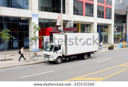 NEW YORK, SEP. 29: White  delivery truck parked in downtown New York City, New York, United States taken on Sep. 29, 2015. - stock photo