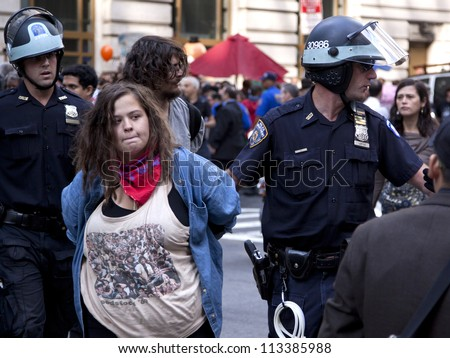 NEW YORK - SEPT 17: An unidentified woman being arrested on the 1yr anniversary of the Occupy Wall St protests on September 17, 2012 in New York City, NY. - stock photo