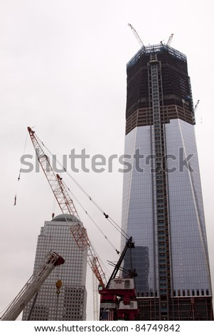 NEW YORK - SEPT 11: One World Trade Center building, still under construction, reaches 80 stories high as of the 10th anniversary of the terrorist attacks  on September 11, 2011 in New York. - stock photo