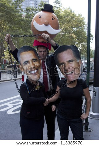 NEW YORK - SEPT 17: Protesters wearing Barrack Obama and Mitt Romney masks shaking hands on the 1yr anniversary of the Occupy Wall St protests on September 17, 2012 in New York City, NY. - stock photo