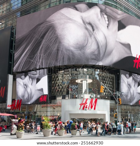 New York - Sept 20 2014: The giant animated billboards of Times Square light up the streets and entertain the thousands of tourists who come to visit on Sept 20, 2014 in New York, USA. - stock photo