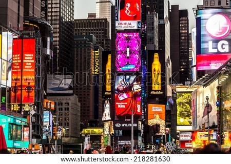 New York - Sept 2014: The glamorous streets of Times Square with thousands of tourists and residents are lit with giant screens displaying colorful advertisements on Sept 7, 2014 in New York, USA.