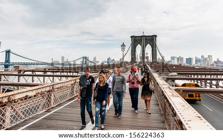 NEW YORK, SEPT 22: Unidentified Pedestrians on brooklyn bridge on September 22 2011 in New York, USA.