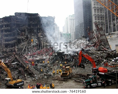 NEW YORK - SEPT 20 :  Workers search through  the debris at Ground Zero World Trade Centre on September 20, 2001 in New York. - stock photo