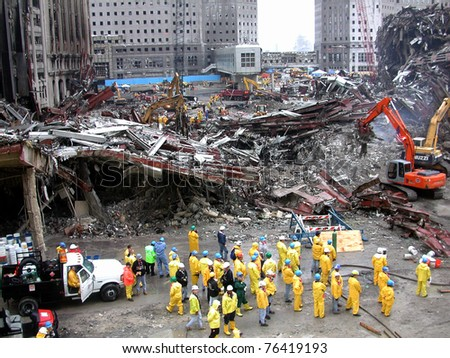 NEW YORK - SEPT 20 :  Workers search through  the debris at Ground Zero World Trade Centre on September 20, 2001 in New York.. - stock photo