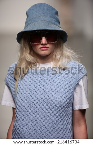 NEW YORK - SEPTEMBER 08: A model walks the runway at Karen Walker Spring-Summer 2015 fashion show during New York Fashion Week on September 08, 2014 in NYC.