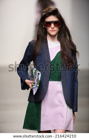 NEW YORK - SEPTEMBER 08: A model walks the runway at Karen Walker Spring-Summer 2015 fashion show during New York Fashion Week on September 08, 2014 in NYC.  - stock photo