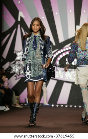 NEW YORK - SEPTEMBER 16: a model walks the runway at the Anna Sui Collection for Spring/Summer 2010 during Mercedes-Benz Fashion Week in New York on September 16, 2009.