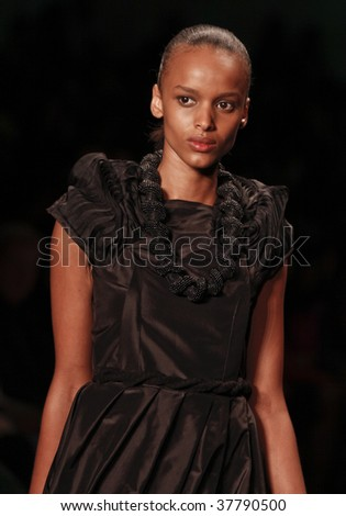 NEW YORK - SEPTEMBER 11: A model walks the runway at the Arise African Collective by David Tlale Collection for Spring/Summer 2010 during Mercedes-Benz Fashion Week on September 11, 2009 in New York. - stock photo