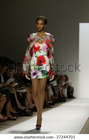 NEW YORK - SEPTEMBER 15: A model walks the runway at the Dennis Basso Collection for Spring/Summer 2010 during Mercedes-Benz Fashion Week on September 15, 2009 in New York