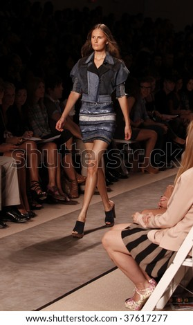 NEW YORK - SEPTEMBER 13: A model walks the runway at the Herve Leger by Max Azria Collection for Spring/Summer 2010 during Mercedes-Benz Fashion Week on September 13, 2009 in New York.