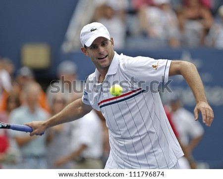 NEW YORK - SEPTEMBER 2: Andy Roddick of USA celebrates victory in 4th round match against Fabio Fognini of Italy at US Open tennis tournament on September 2, 2012 in Flashing Meadows New York - stock photo