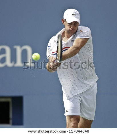 NEW YORK - SEPTEMBER 2: Andy Roddick of USA returns ball during 4th round match against Fabio Fognini of Italy at US Open tennis tournament on September 2, 2012 in Flushing Meadows New York - stock photo